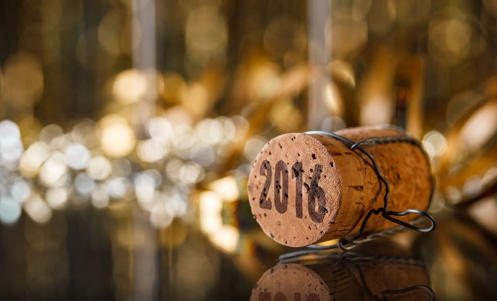Cork with 2016 on it, resting on decorated table